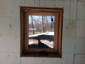 Window from the interior after exterior taping is complete.