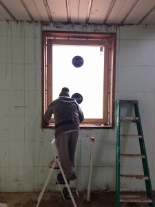 Shimming a window, checking plumb and level